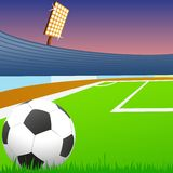 Soccer ball on green field of the stadium Royalty Free Stock Photo