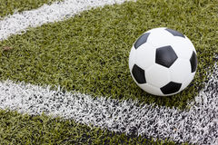 Soccer ball on green field Royalty Free Stock Photos
