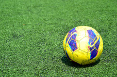 Soccer Ball on Green Fields. Old Soccer Ball on Green Artificial glass Fields Royalty Free Stock Images