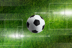 Soccer ball, green filed Stock Photography