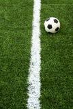 Soccer ball on green grass Stock Image