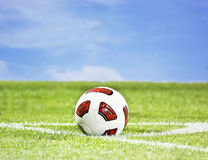 Soccer ball on green grass. And blue sky background Royalty Free Stock Photos