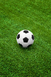 Soccer ball on green grass. Field Stock Images