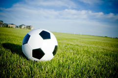 Soccer ball on green grass. In nice rural community very peaceful and green stock images