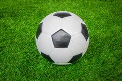 Soccer ball on green grass . Stock Photography