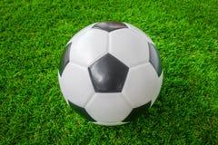 Soccer ball on green grass . Stock Photo