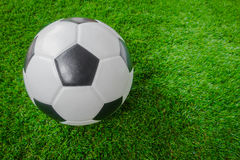 Soccer ball on green grass . Royalty Free Stock Images
