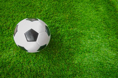 Soccer ball on green grass . Stock Image