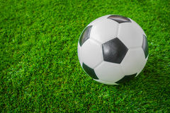 Soccer ball on green grass . Royalty Free Stock Photo