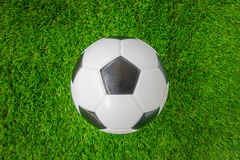 Soccer ball on green grass . Stock Photography
