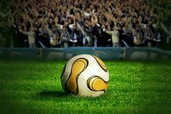 Soccer ball on green grass. And blue sky background stock images