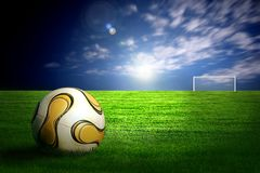 Soccer ball on green grass. And stadins light royalty free stock photography