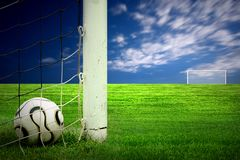 Soccer ball on green grass. And blue sky background stock photography