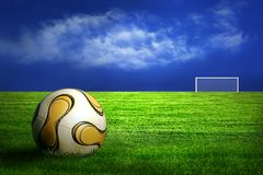 Soccer ball on green grass. And blue sky background stock photo