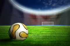 Soccer ball on green grass. And stadins light stock photo