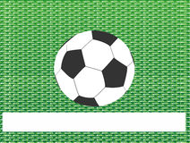 Soccer ball on green grass abstract background Stock Image