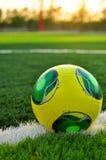 Soccer ball on green grass Stock Photos