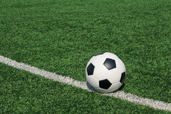Soccer ball green grass field Stock Images
