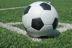 Soccer ball green grass field Stock Photos