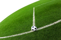 Soccer ball on green grass field isolated. On white bakcground stock photo