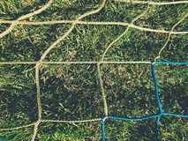 Soccer ball green grass field, soccer line. Hang bended blue yellow soccer nets Stock Image