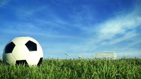 Soccer ball on green grass field for sport event Royalty Free Stock Photo