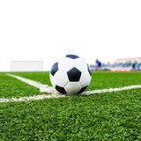 Soccer ball on green grass field  Royalty Free Stock Photography