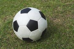 Soccer ball on green grass, football Stock Photography