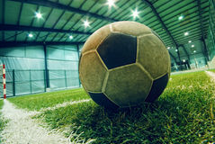 Soccer ball on green grass in an indoor playground stock photography