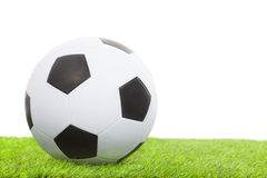Soccer ball on green grass isolated on white Stock Photos