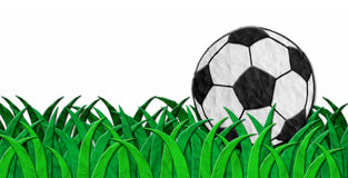 Soccer ball on green grass made from clay Stock Photo