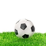 Soccer ball on green grass over white Royalty Free Stock Photo