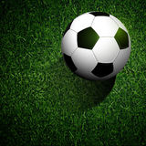 Soccer ball on green grass. Soccer Ball On Realistic Green Grass Background Stock Images
