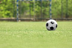 Soccer ball on green grass. At the stadium stock photo