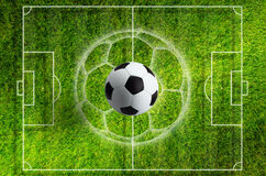 Soccer ball on green grass stadium with white layout Royalty Free Stock Photo
