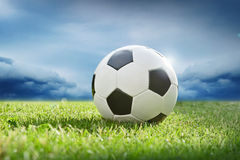 Soccer ball on green grass. Before the storm royalty free stock photography