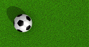 Soccer ball on green grass Royalty Free Stock Images