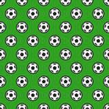 Soccer Ball on Green Seamless Background Royalty Free Stock Photography