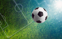 Soccer ball on green soccer field Royalty Free Stock Photos