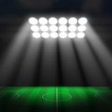 Soccer ball on green stadium Stock Images