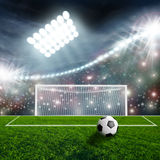 Soccer ball on green stock photography