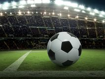 Soccer ball on green stadium, arena in night illuminated bright spotlights. For design In the media Advertising Royalty Free Stock Photography