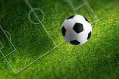 Soccer ball on green stadium Stock Image