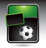 Soccer ball on green stylized banner Stock Photos