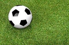 Soccer ball on ground Stock Photo
