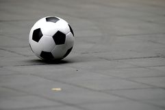 Soccer ball on ground Stock Photo