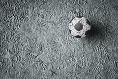 Soccer ball on ground with imprint of shoes Stock Photography