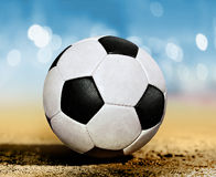 Soccer ball on ground l Royalty Free Stock Photography