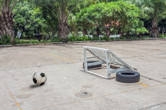 Soccer ball on ground Stock Images