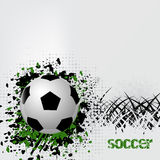 Soccer ball with grunge effect and grass Stock Photo